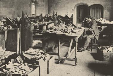 Solomon Schecter examines manuscripts from the Cairo Geniza